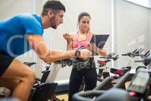 Trainer timing man on exercise bike