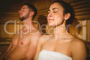 Happy couple enjoying the sauna together