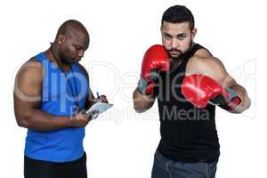 Boxing coach with his fighter