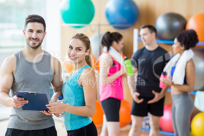 Client and trainer looking at clipboard