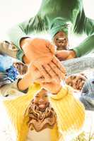 Young family doing a head circles and joining their hands