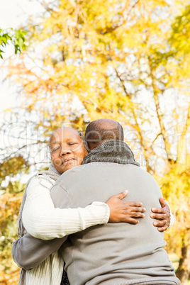 Peaceful happy senior couple embracing