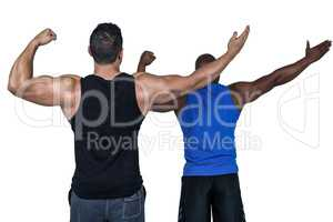 Strong friends posing with arms out