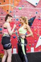 Fit women getting ready to rock climb