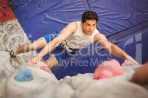Man climbing up rock wall