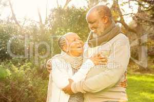 Happy peaceful senior couple embracing