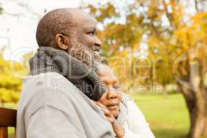 Peaceful senior couple sitting on a bench