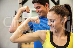 Happy couple showing off their biceps