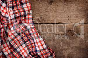 Checkered table cloth on wood