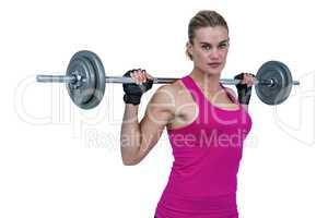 Sporty female bodybuilder lifting barebell