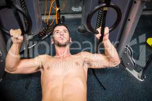 Man holding large rings in his workout