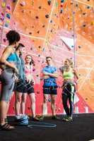 Fit people getting ready to rock climb