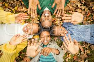 Young family doing a head circles and raising their hands