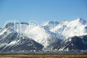 Snow-covered volcanic mountain landscape in Iceland