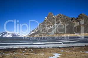 Snow-covered volcanic mountain landscape