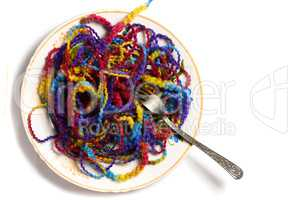 Full plate of melange yarn with a fork