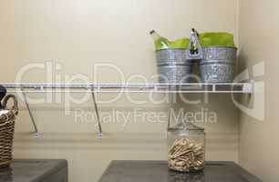 Laundry Room with Buckets and Jar of Clothes Pins