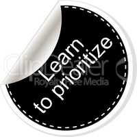 Learn to prioritize. Inspirational motivational quote. Simple trendy design. Black and white stickers.