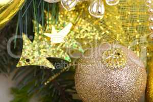 luxury gift boxes under Christmas tree, New Year home decorations, golden wrapping of Santa presents, festive fir tree decorated with garland, baubles set, traditional celebration