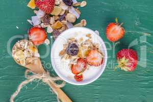 Yogurt with cereals muesli and fresh strawberries