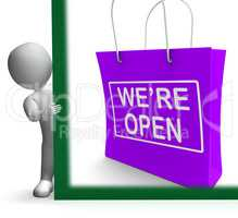 We're Open Shopping Bag Sign Shows New Store Launch