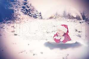 Composite image of festive child in snow globe