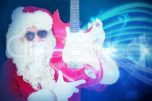 Composite image of cool santa showing electric guitar
