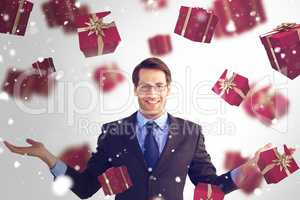 Composite image of businessman with open hands looking at the ca