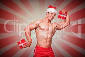 Composite image of shirtless macho man in santa hat holding gift