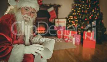 Smiling santa claus holding a scroll