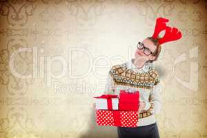 Composite image of thoughtful geeky hipster holding presents