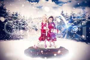Composite image of festive child in snow globe