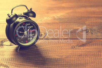 Alarm Clock On Wood Table