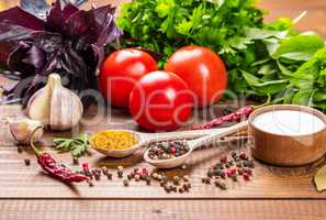 Raw vegetables, basil and spices on the wood table