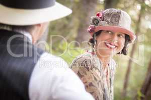 Romantic 1920s Dressed Couple Flirting Outdoors