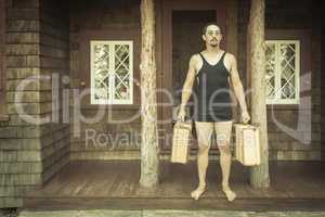 Gentleman Dressed in 1920?s Era Swimsuit Holding Suitcases on