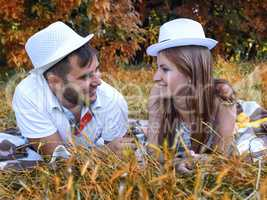 happy young couple relaxing in the park on the grass