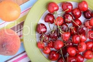 mandarin, peach and cherry fresh fruits and berries, summer health food, top view