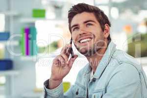 Creative businessman working on his smartphone