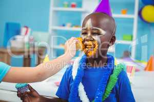 Smiling kid with icing on his face