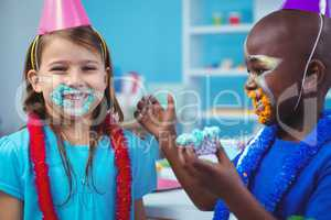 Smiling kids with icing on their faces