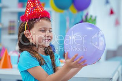 Happy kid holding a balloon