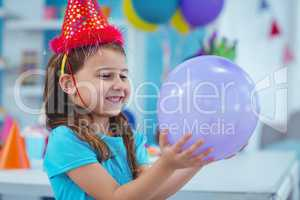 Happy kid holding a balloon