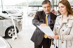 Salesman explaining the contract to a client