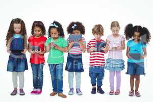 Kids standing together holding tablets and phones