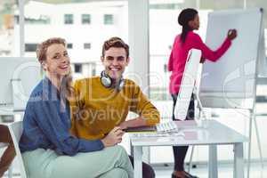 Graphic designer wearing headphones at desk