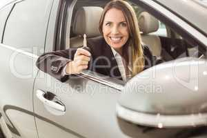 Smiling businesswoman holding car key