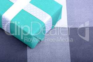 holiday Green gift box with white ribbon