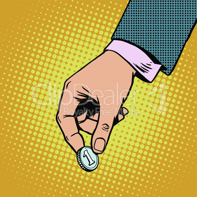 Monetary contribution. The hand holds a coin. Business concept
