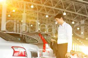 Businessman at car park